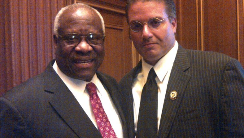Mr. Castellanos with Clarence Thomas, an Associate Justice of the Supreme Court of the United States